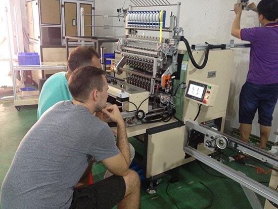 Russian customer representatives come to our company to learn twelve axis automatic winding machine